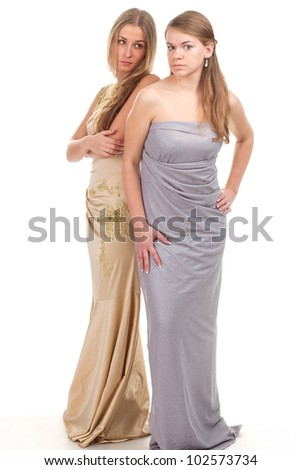 Hall envious friends - two girls in dresses with gold and silver on a white background - stock photo