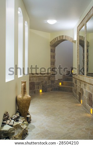 Hall interior with staircase, niches and mirrors - stock photo