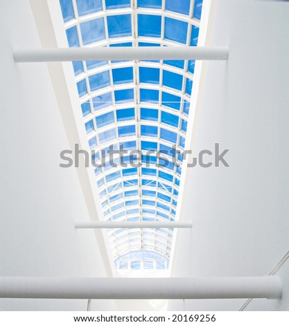 hall of a business building with columns and light from a window - stock photo