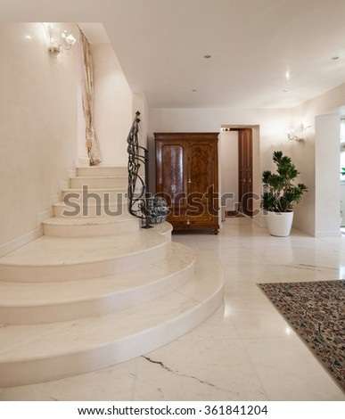 Hall of a luxury mansion, marble staircase - stock photo