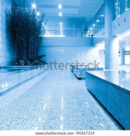 Hall of business building with light from window - stock photo