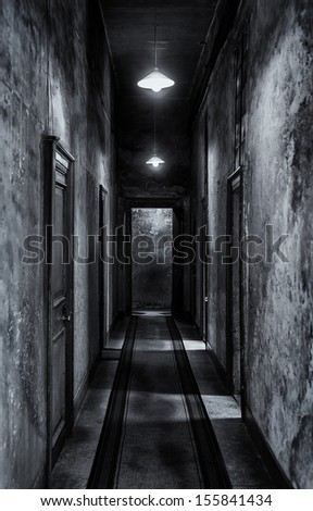 Hall of doors. Built in the eighteenth century. Abandoned and forgotten in the mid twentieth century, dirty, cold, damp, dark, and moldy. Fine art - stock photo