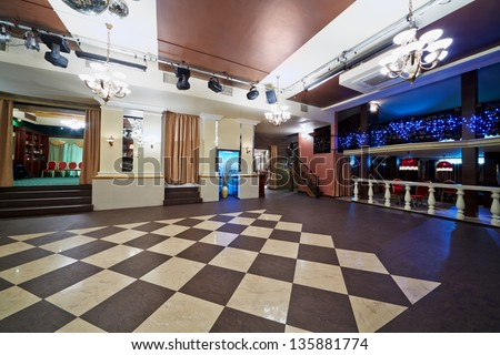 Hall with checkered floor in cafe - stock photo