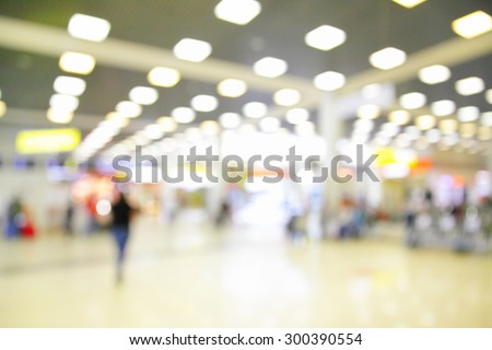 Hall with duty free shops in airport out of focus - defocused blurred background - stock photo