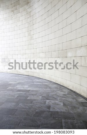 Hall with stone wall, detail of a large hall inside a building
