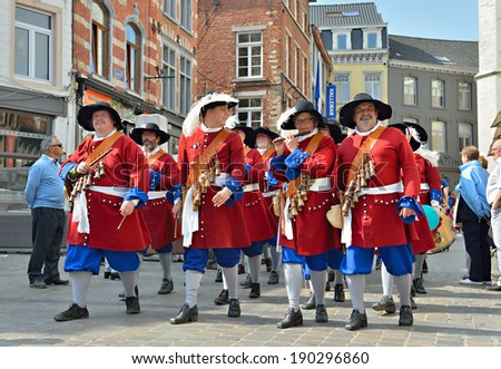 HALLE, BELGIUM-MAY 01, 2014: Participants in historical costumes in defile during activities on Labour Day and Zenne folkloric celebration on Grand Place in Halle - stock photo