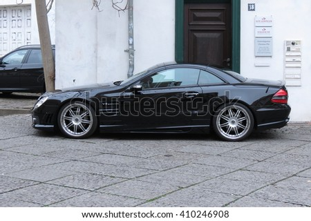 HALLE (SAALE), GERMANY - CIRCA MARCH 2016: black Mercedes-Benz SL 55 car parked in a street of the city centre - stock photo