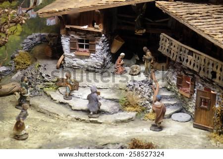 HALLEIN, AUSTRIA - DECEMBER 14: Nativity scene, creche or crib, is a depiction of the birth of Jesus, Hallein, Austria on December 14, 2014. - stock photo