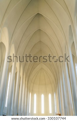 Hallgrimskirkja Cathedral in Reykjavik, Iceland. The Lutheran (Church of Iceland) parish church in Reykjavik, Iceland. At 73 metres (244 ft), it is the largest church in Iceland. - stock photo