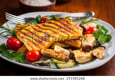 Halloumi grilled cheese on mushrooms and vegetables - stock photo