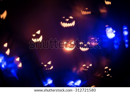 Halloween abstract glowing blurred background. Close up bokeh. Defocused blinking shaped lights. Halloween Background. Holiday backdrop - stock photo