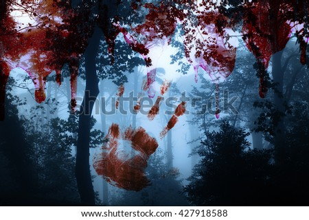 Halloween background. Bloody hand print and blood streaks on the background of the misty forest - stock photo