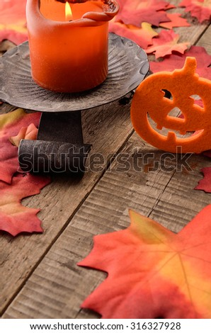 Halloween background with candle light on a wooden table