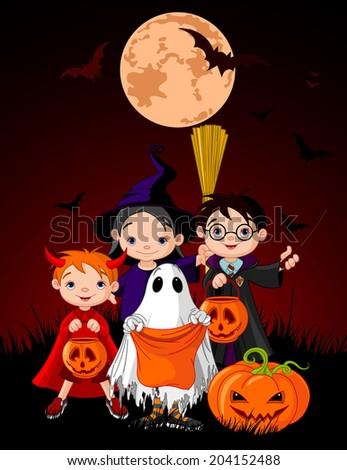 Halloween background with children trick or treating in Halloween costume  - stock photo
