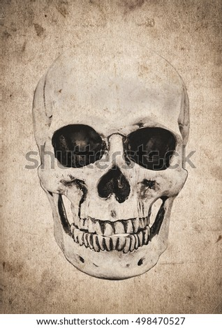 Halloween background with human skull on old vintage newspaper