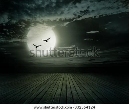 Halloween background, Wooden floor with blurred full moon, Dark style. - stock photo