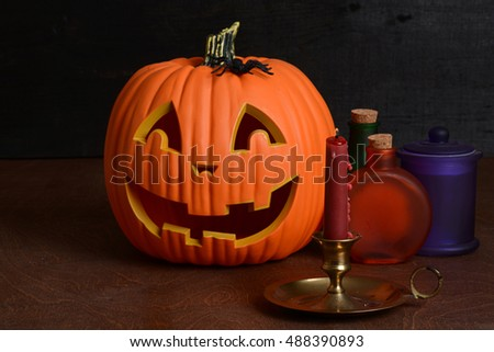 Halloween candle with pumpkin and bottles