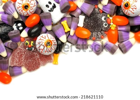 Halloween candy corner border over a white background - stock photo