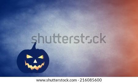 Halloween carved pumpkin on blue / orange background , jack o' lantern , copyspace - stock photo