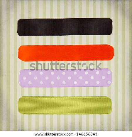 Halloween colored ribbon tags on a scrapbook paper background