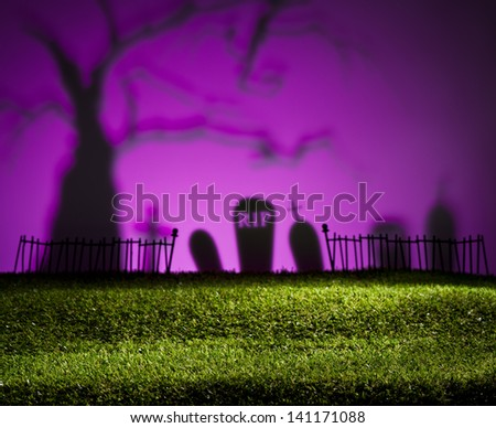 Halloween colorful landscape with tree and graveyard - stock photo