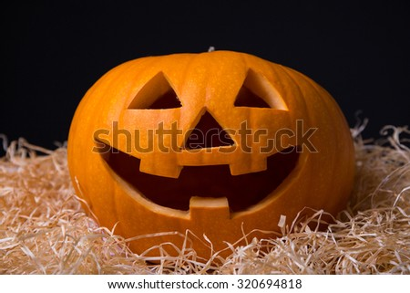 Halloween concept - close up of pumpkin Jack-O-Lantern with happy face - stock photo