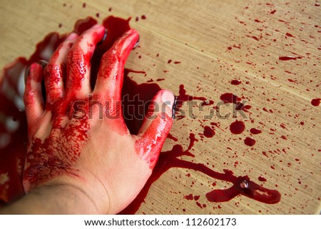 Halloween concept : Hand in blood