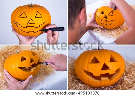 halloween concept - man with knife making pumpkin for Halloween