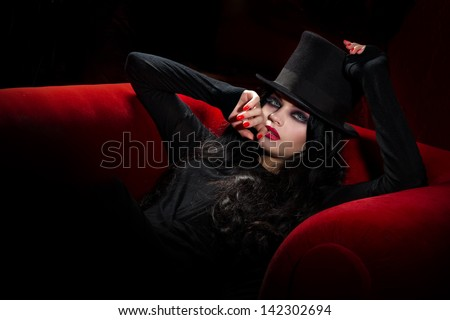Halloween concept: sexy lady vampire over red background - stock photo