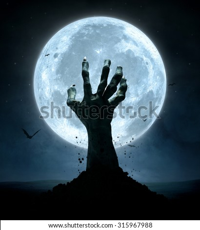 Halloween concept, zombie hand coming out from the grave - stock photo