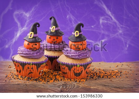 Halloween cupcake with pumpkins with witch hat - stock photo