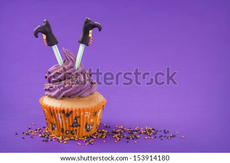 Halloween cupcake with witch legs - stock photo