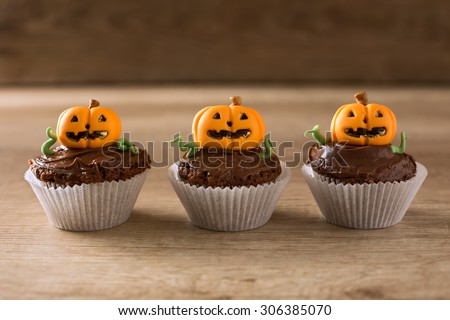 Halloween cupcakes on wood background - stock photo