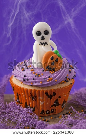 Halloween cupcakes with ghosts and pumpkins - stock photo