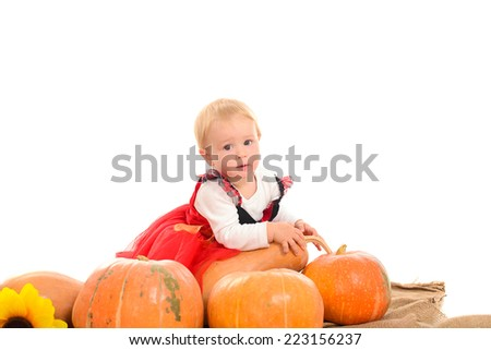 Halloween cute little witch with pumpkins