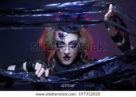 Halloween. Dark Doll. Young woman in holiday image of mystery gothic doll. - stock photo