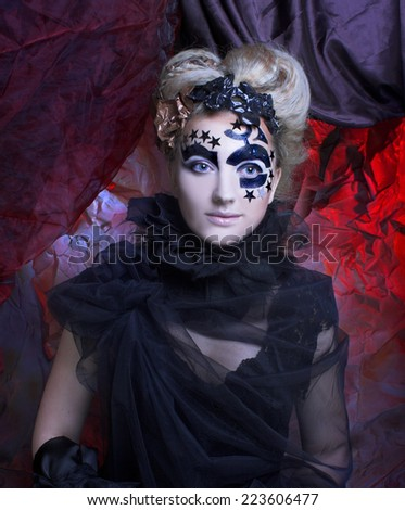 Halloween Dark Lady. Portrait of young woman in black with artistic makeup and hairstyle.