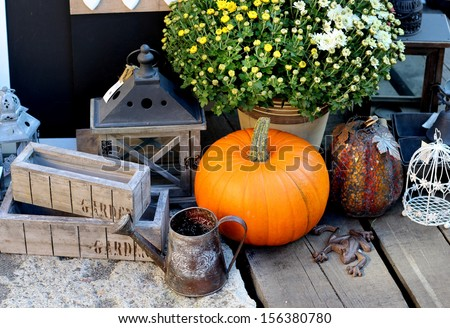 Halloween decorations with pumpkin and other decor objects  - stock photo