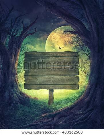 Halloween design. Festive background with autumn valley with woods, spooky tree and full moon. Space for your Halloween holiday text. Wooden sign