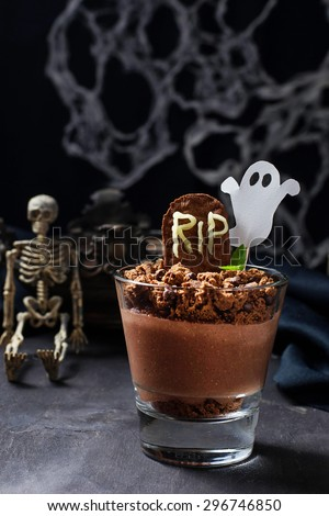 Halloween dessert with tombstone and ghost. Selective focus - stock photo