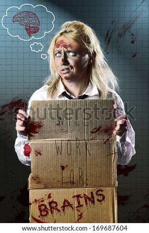 Halloween fine art portrait of an unemployed business zombie standing at underground subway holding cardboard sign WILL WORK FOR BRAINS. Funny horror poster artwork