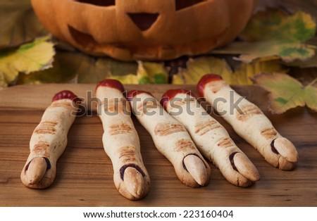Halloween finger cookies on the wooden desk - stock photo