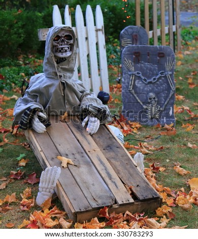 Halloween ghost and wooden coffin decorations