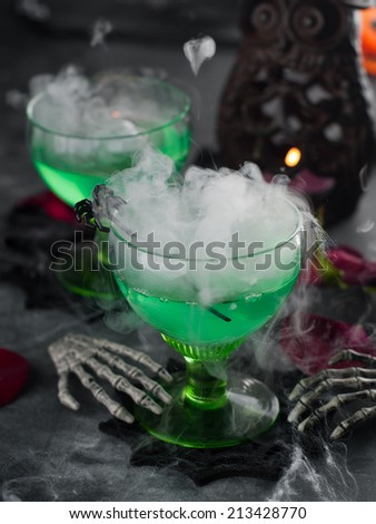 Halloween green drink for party, selective focus - stock photo
