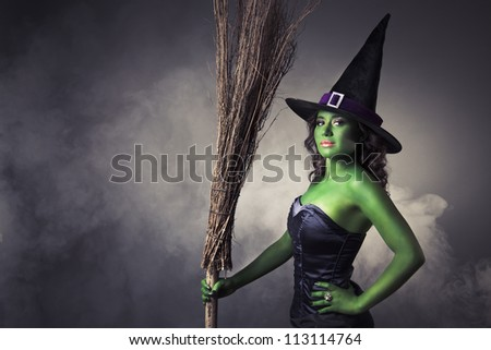 Halloween green witch on a grey background