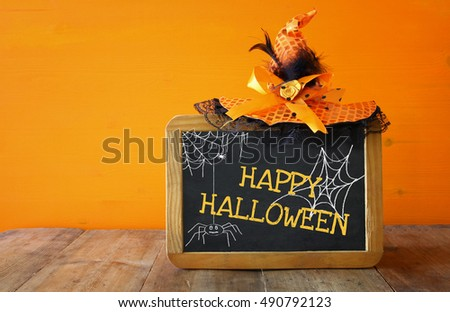 Halloween holiday concept. Witch hat next to blackboard