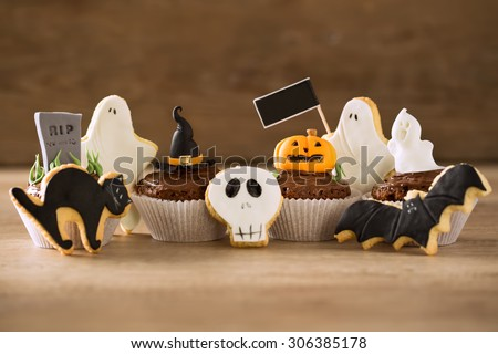Halloween homemade gingerbread cookies and cupcakes background - stock photo