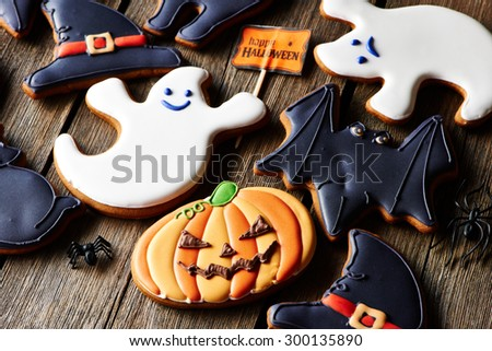 Halloween homemade gingerbread cookies over wooden table - stock photo