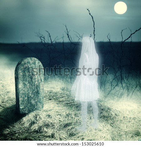 Halloween horror concept - afterlife. Young white transparent woman ghost look on her grave gravestone on old cemetery. Midnight with full moon - stock photo