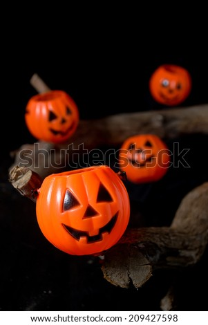 Halloween jack-o-lantern buckets on a dark background - stock photo